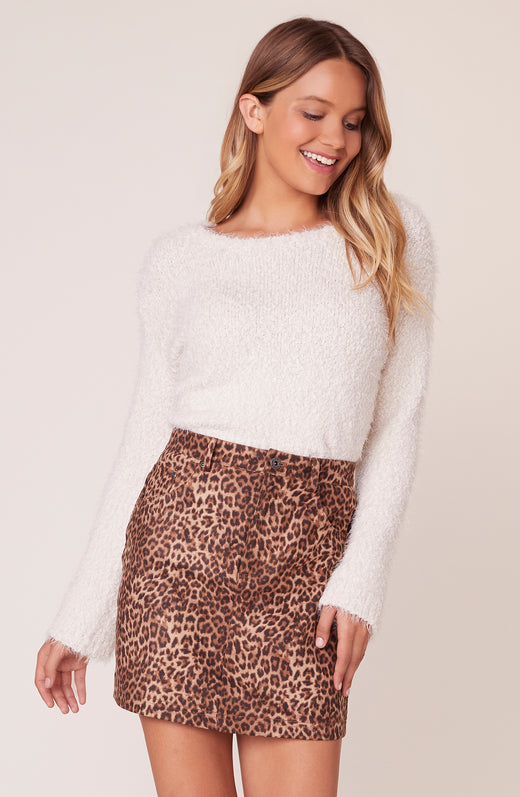 Model wearing faux suede leopard print mini skirt