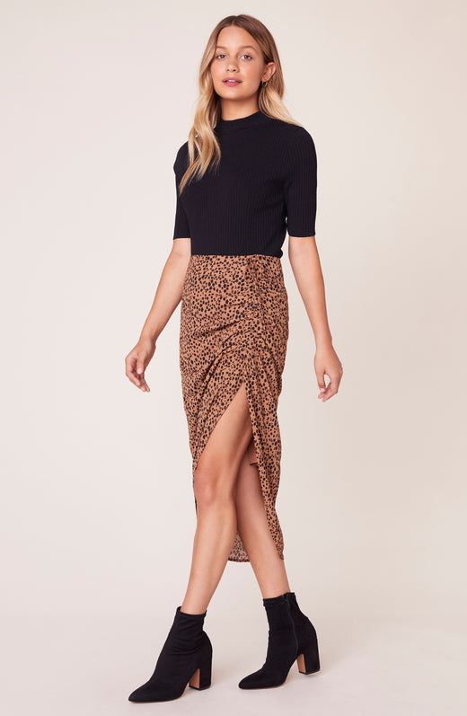 Model wearing ruched leopard print skirt