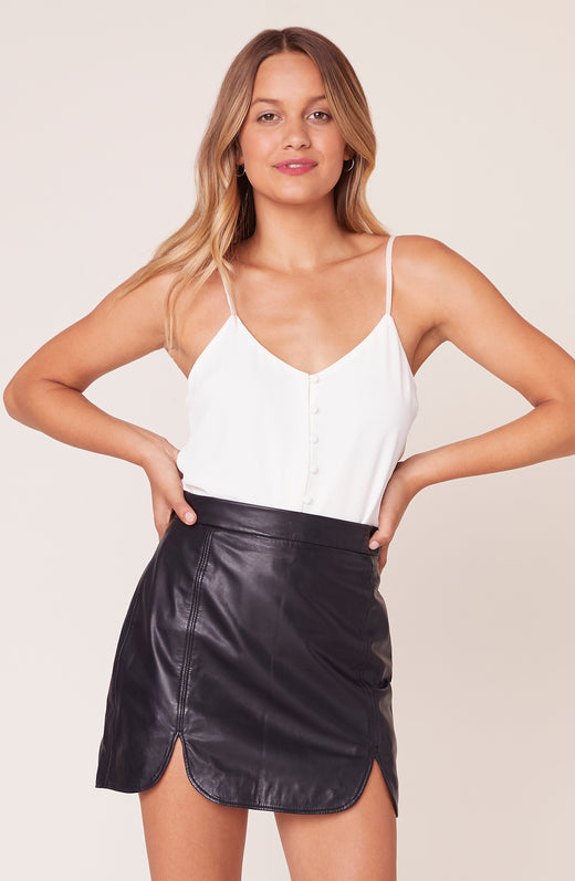 Model wearing leather skirt with slit hemline