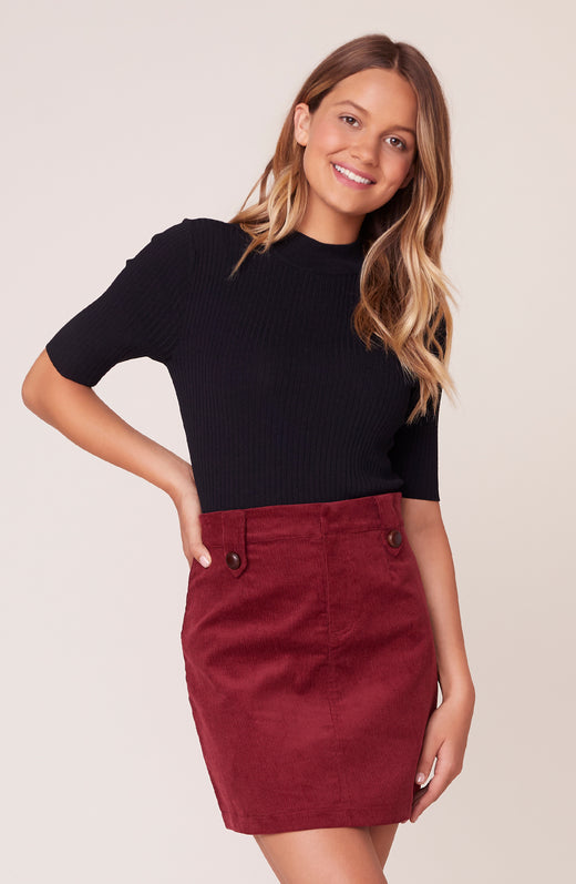 Model wearing burgundy corduroy mini skirt