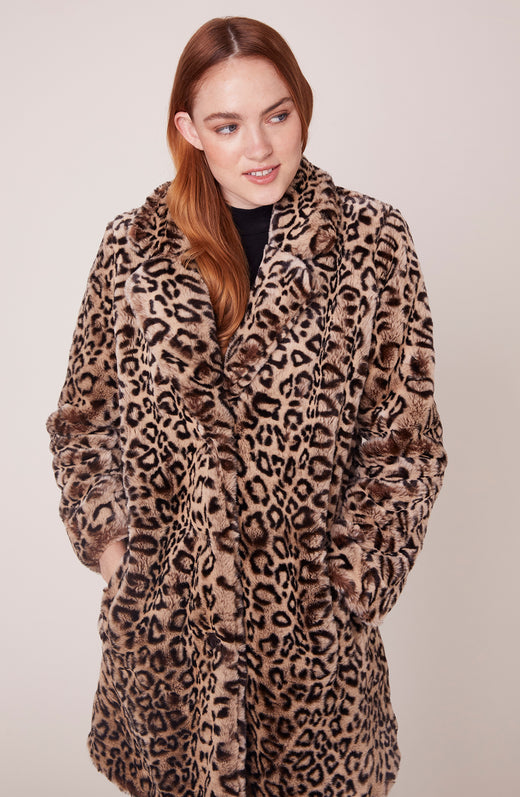 Model wearing leopard printed faux fur coat