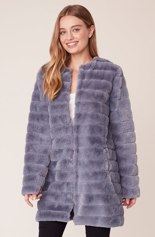Model wearing blue faux fur coat