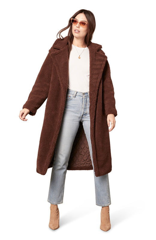 oversize teddy coat with a knee-length silhouette and single button closure.