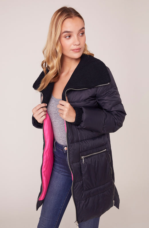 Model wearing black puffer coat