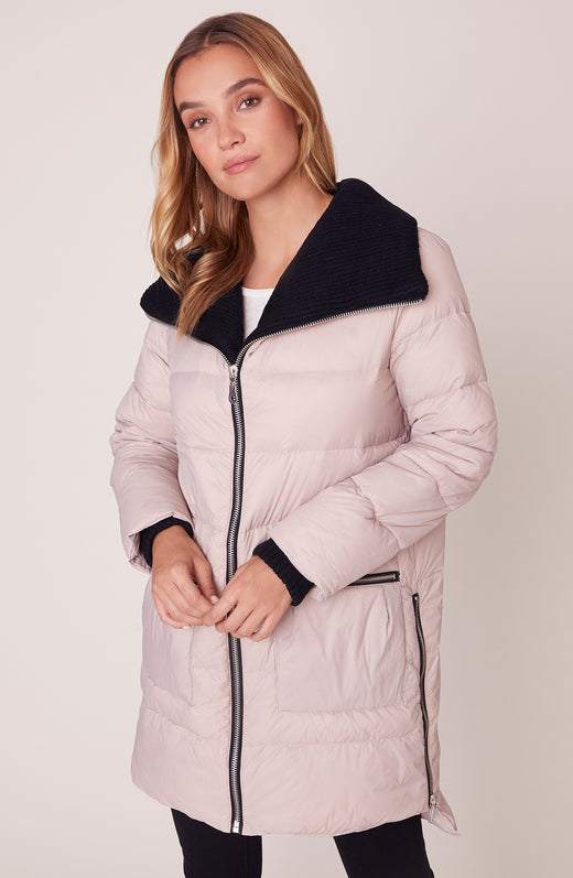 Model wearing light pink puffer coat