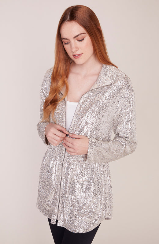 Model wearing silver sequin anorak jacket