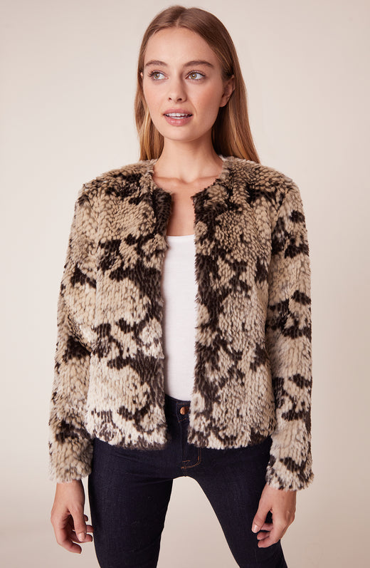 Model wearing faux fur snake printed jacket
