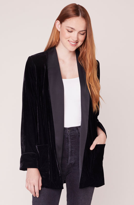 Model wearing velvet and satin oversized blazer