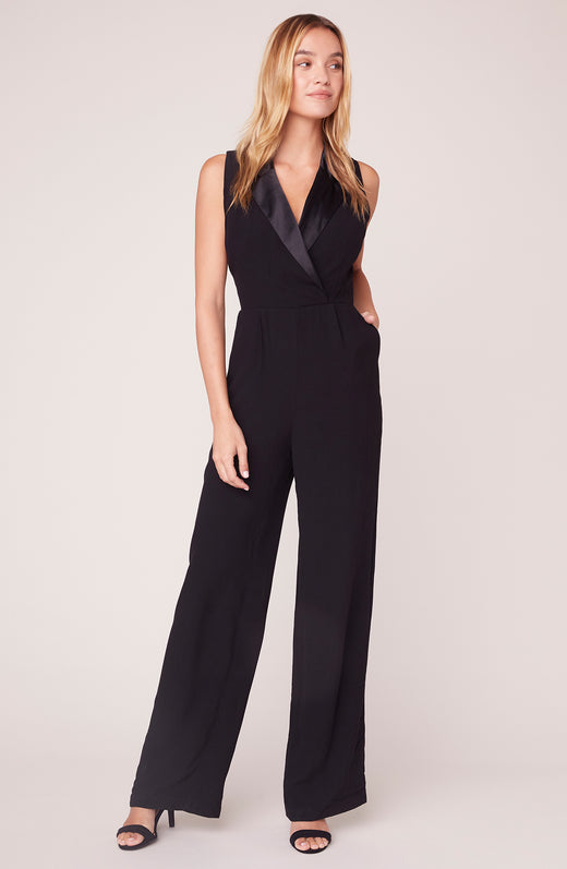 Model wearing black tuxedo jumpsuit