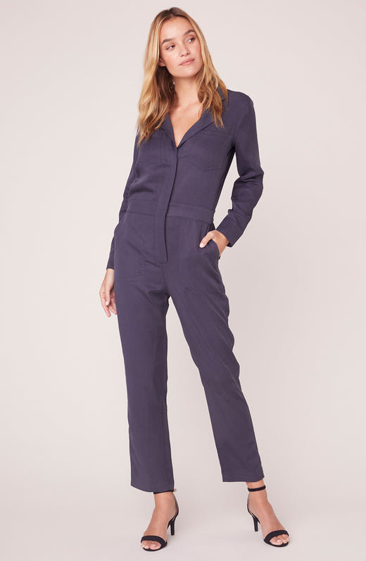 Model wearing grey long sleeve boiler suit