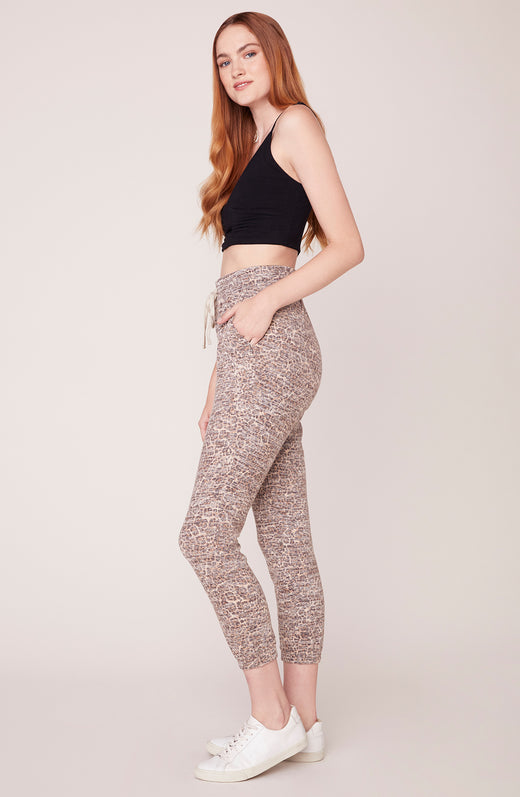 Side view of model wearing leopard printed joggers