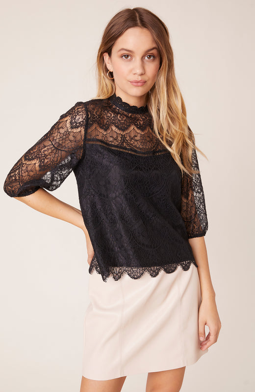 Model wearing lace black top