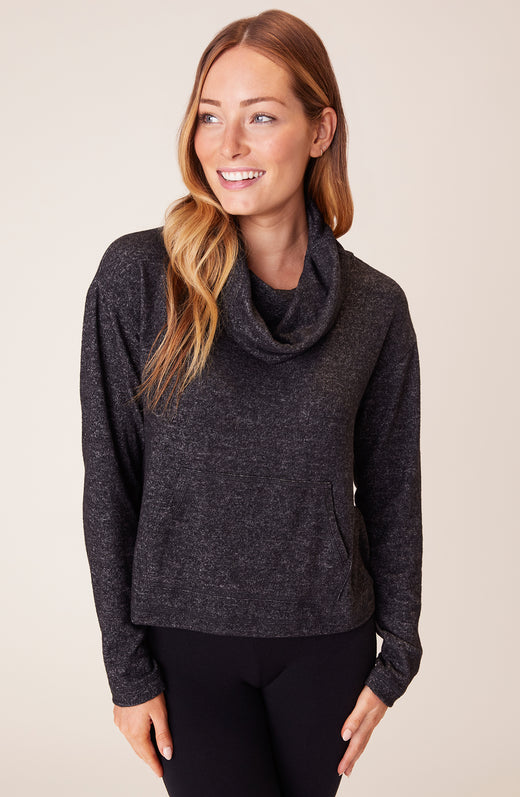 Model wearing cowl neck sweatshirt