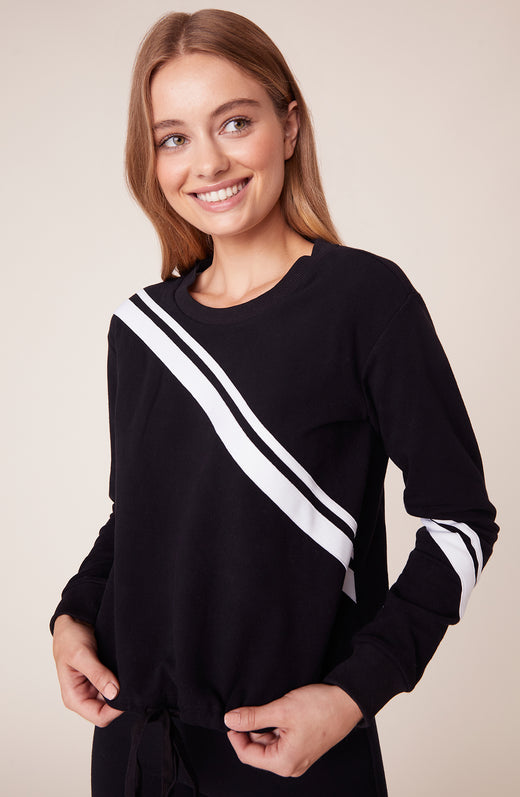 Model wearing black sweatshirt with white stripe