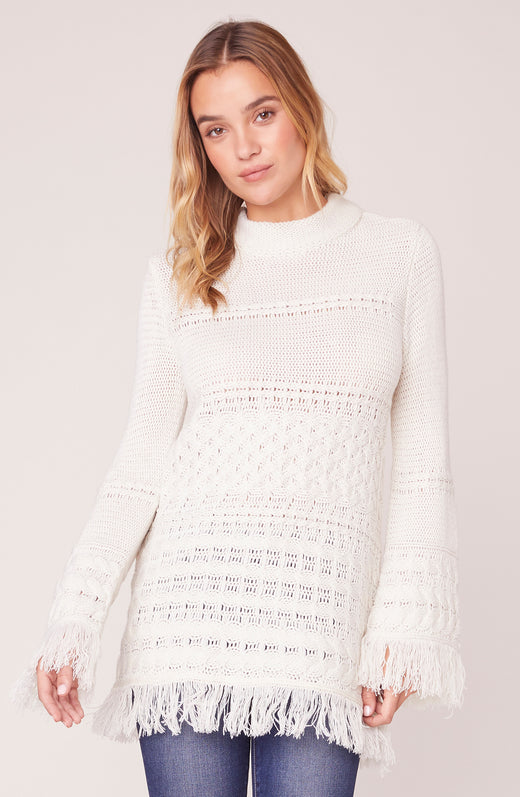 Model wearing ivory fringe sweater