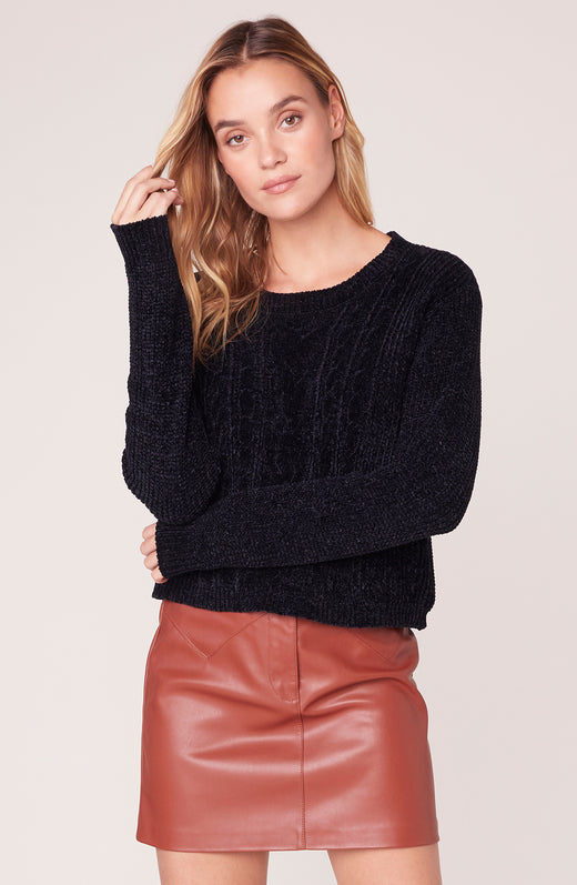 Model wearing black chenille sweater