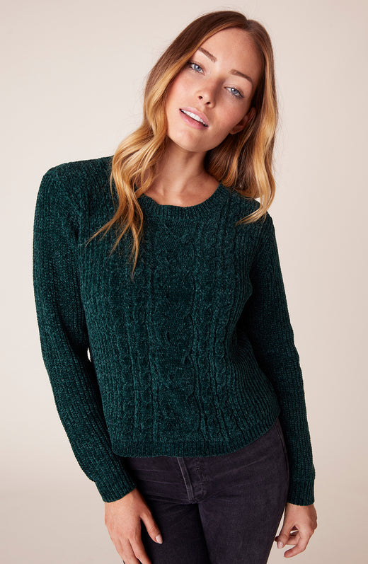 Model wearing green chenille sweater