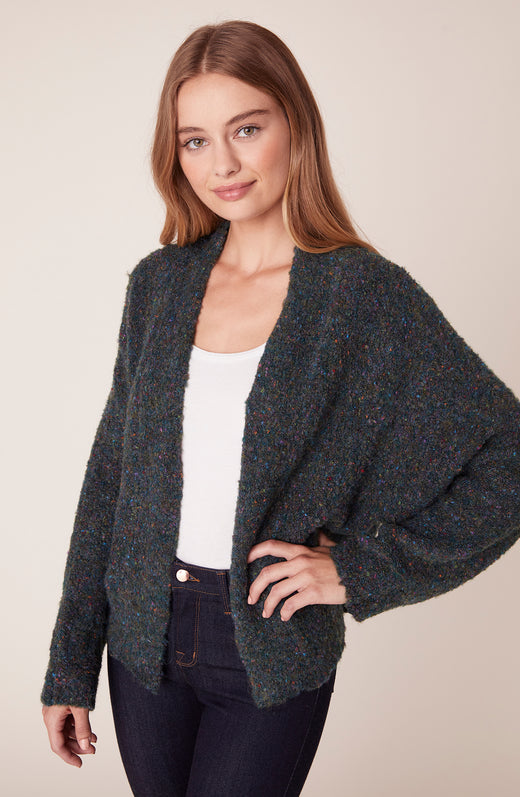 Model wearing speckled cardigan