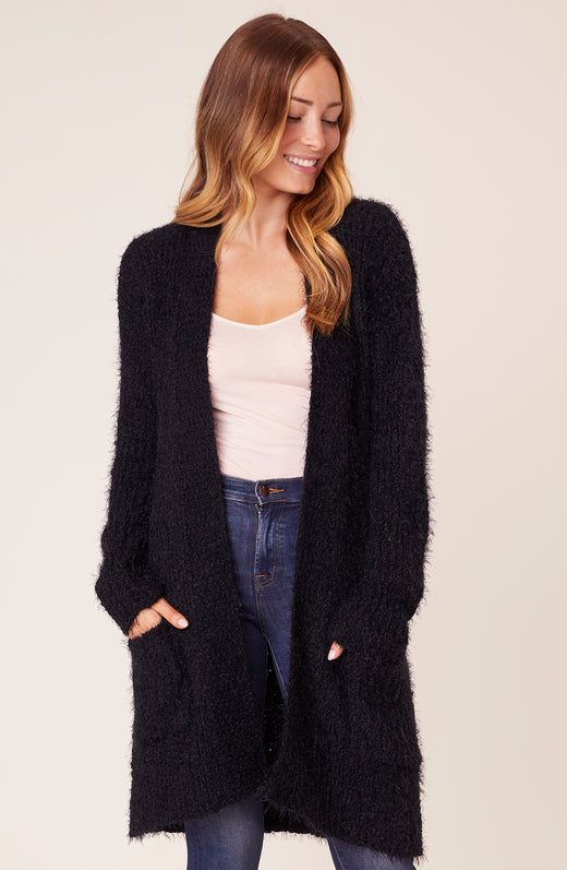 Model wearing long cardigan