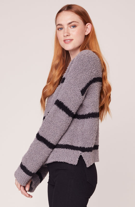 Model wearing striped chenille sweater