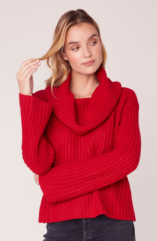 Model wearing chunky knit red sweater