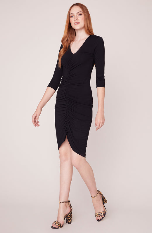 Model wearing 3/4 sleeve black ruched dress