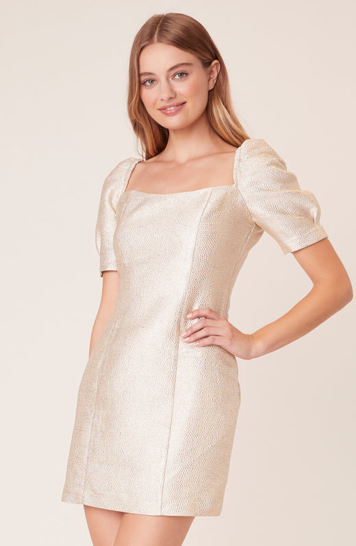 Model wearing silver short sleeve dress