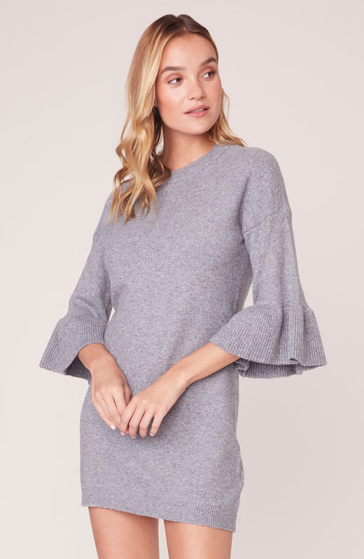 Model wearing heather grey 3/4 sleeve mini dress with ruffles