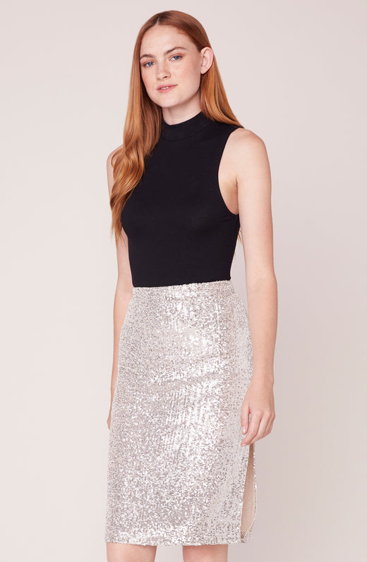 Model wearing silver sequin skirt