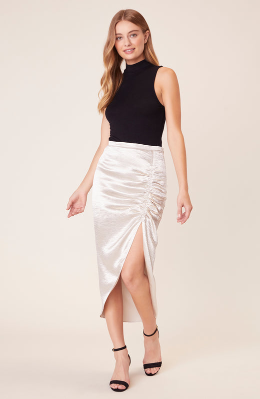 Model wearing silver ruched midi skirt