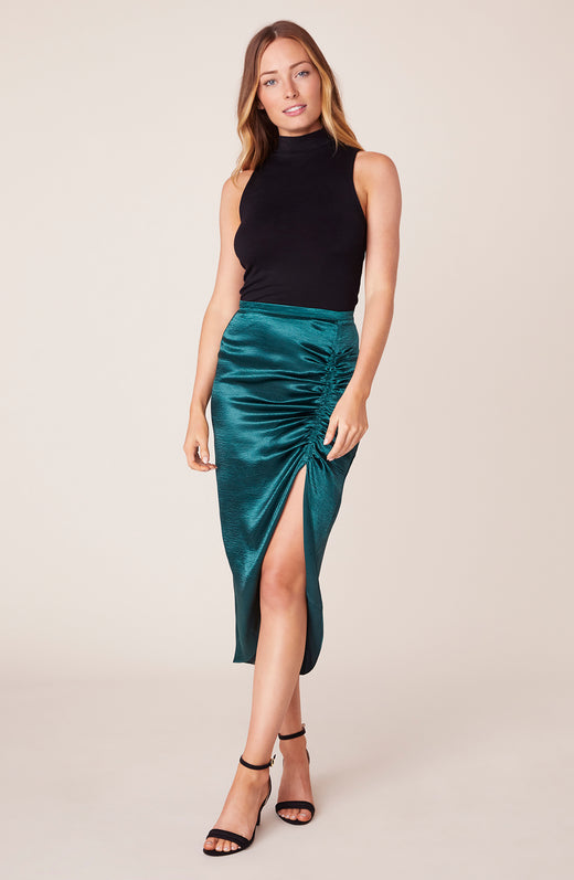Model wearing green ruched midi skirt