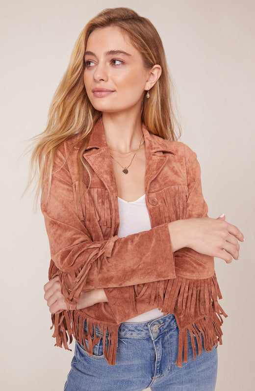 Model wearing faux suede fringed jacket