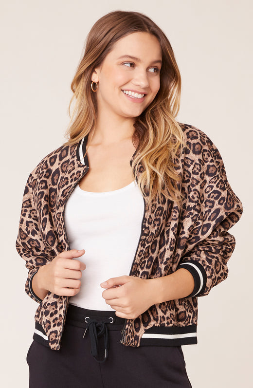 Model wearing leopard print vegan suede bomber jacket