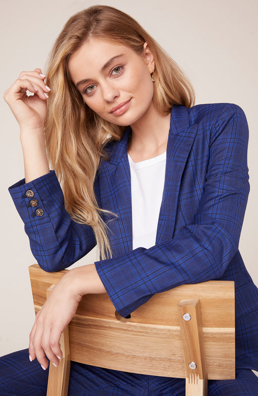 Model sitting wearing blue boyfriend blazer