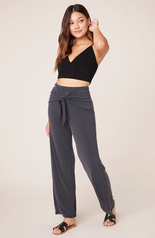 Model wearing charcoal grey relaxed pants
