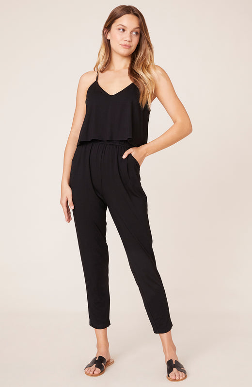 Model wearing tapered leg, black jumpsuit