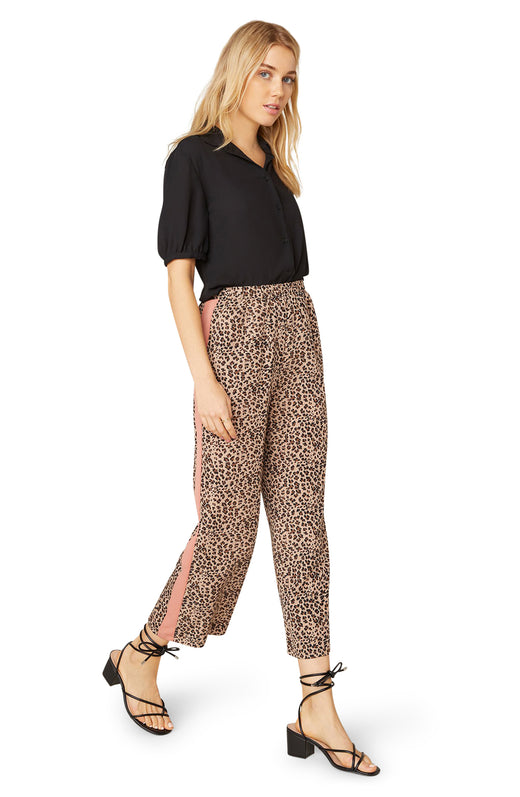 Model wearing leopard print pant with side stripe