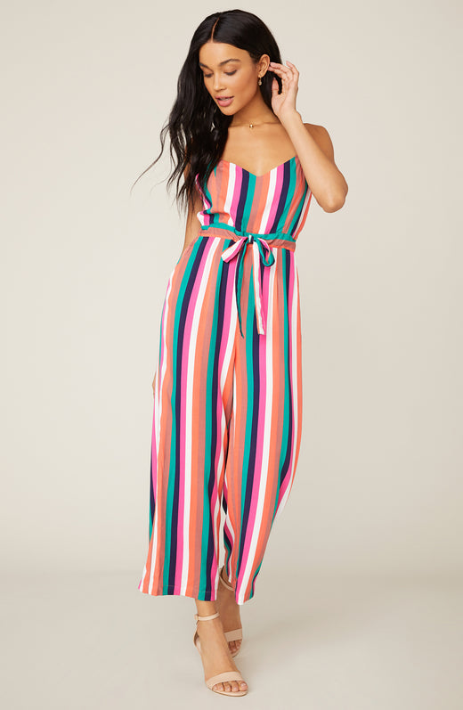 Model wearing multicolored stripe jumpsuit