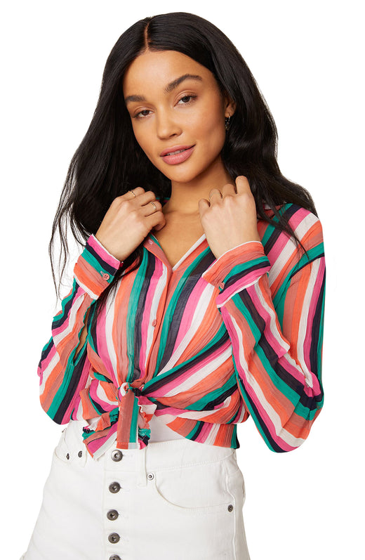 Model wearing long sleeve striped button top