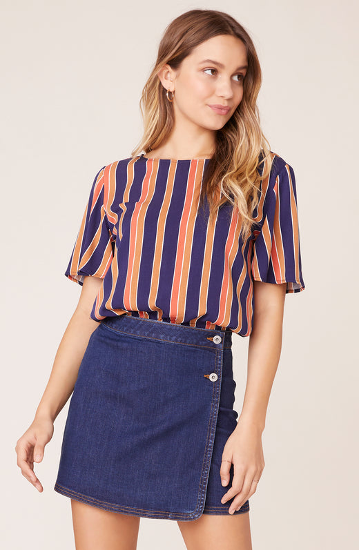 Model wearing vertical stripe top