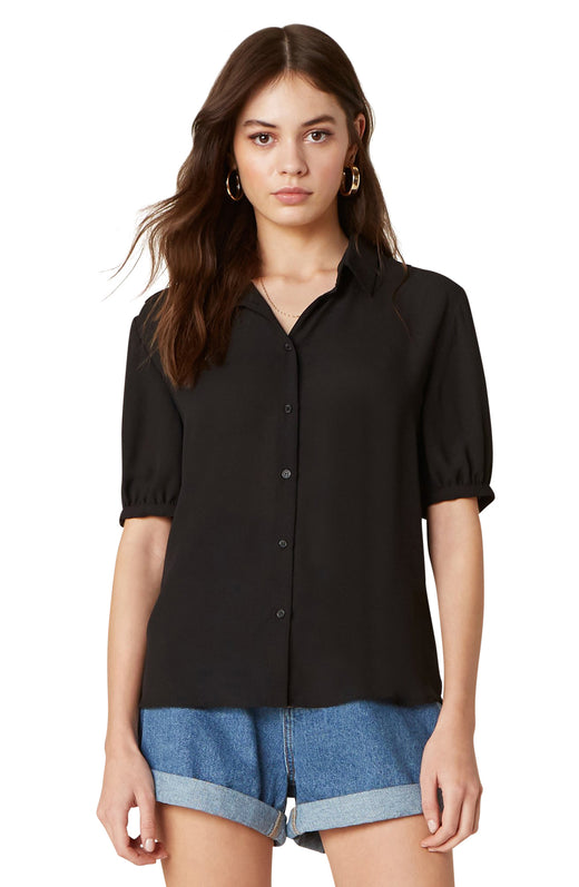 Model wearing button up black blouse