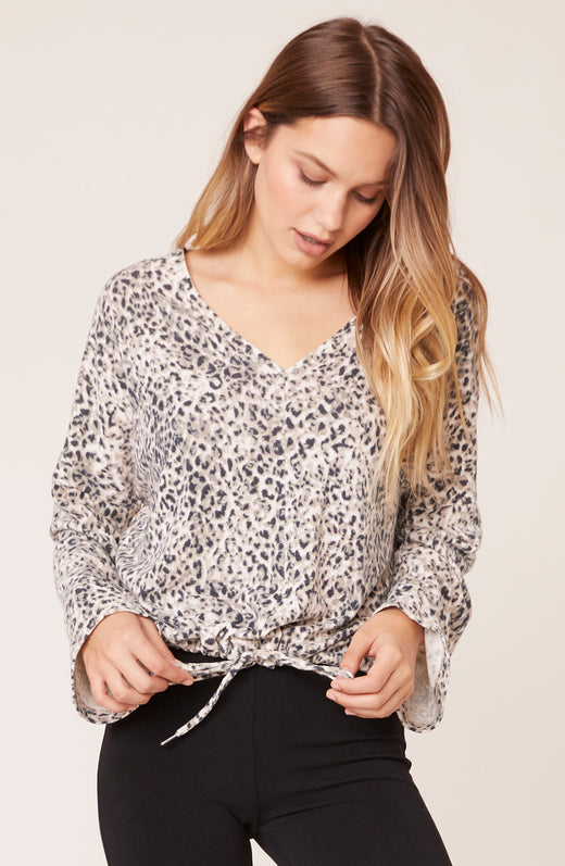 Model wearing cheetah long sleeve top