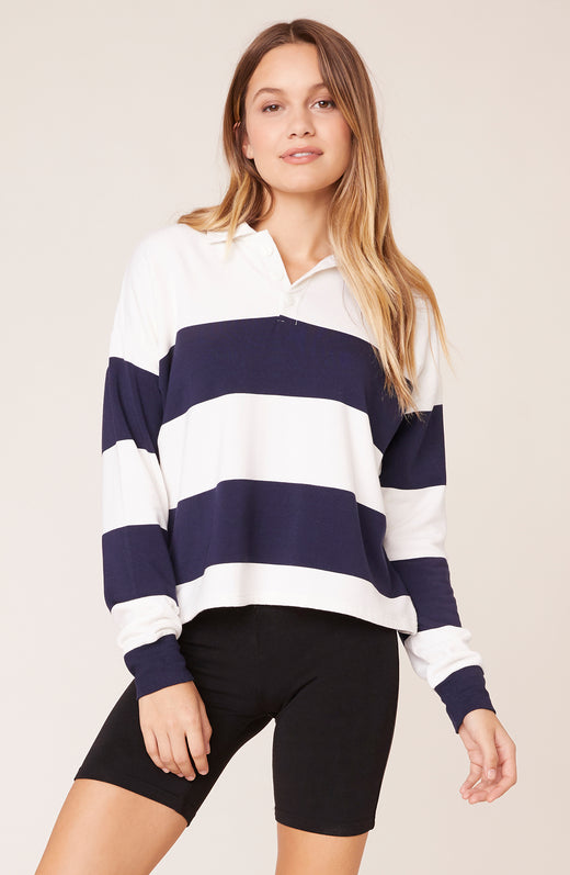 Model wearing long sleeve striped polo top