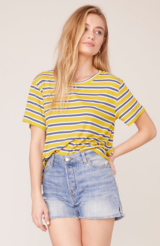 Model wearing golden yellow striped tee