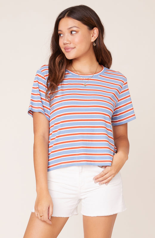 Model wearing striped tee