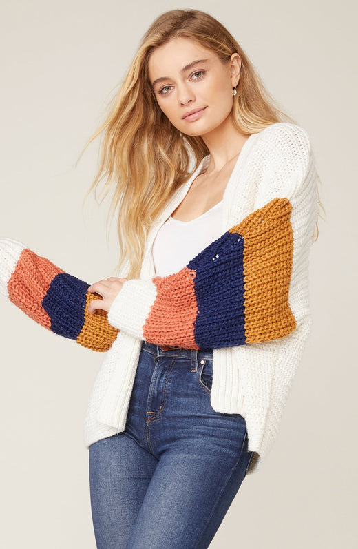 Model wearing oversize cardigan with color blocked sleeves