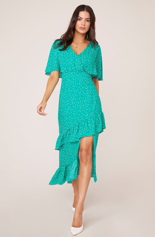 Model wearing green polka dot midi dress