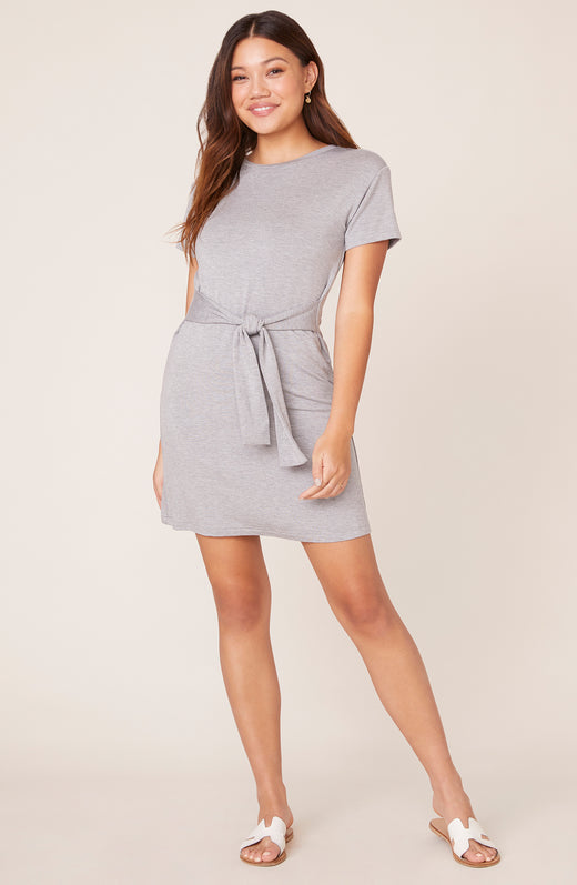 Model wearing grey t-shirt dress