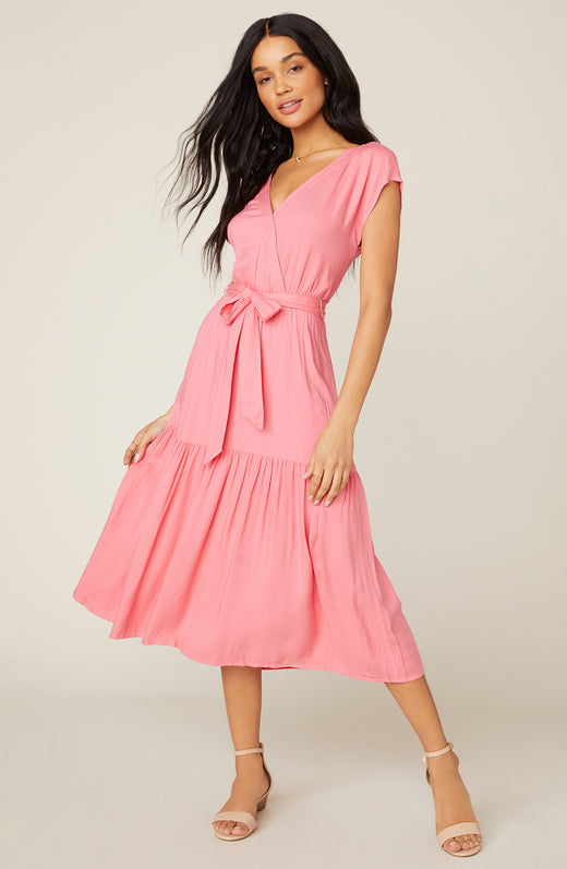Model wearing pink tiered midi dress