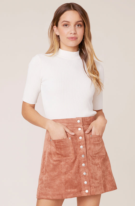 Model wearing vegan suede mini skirt